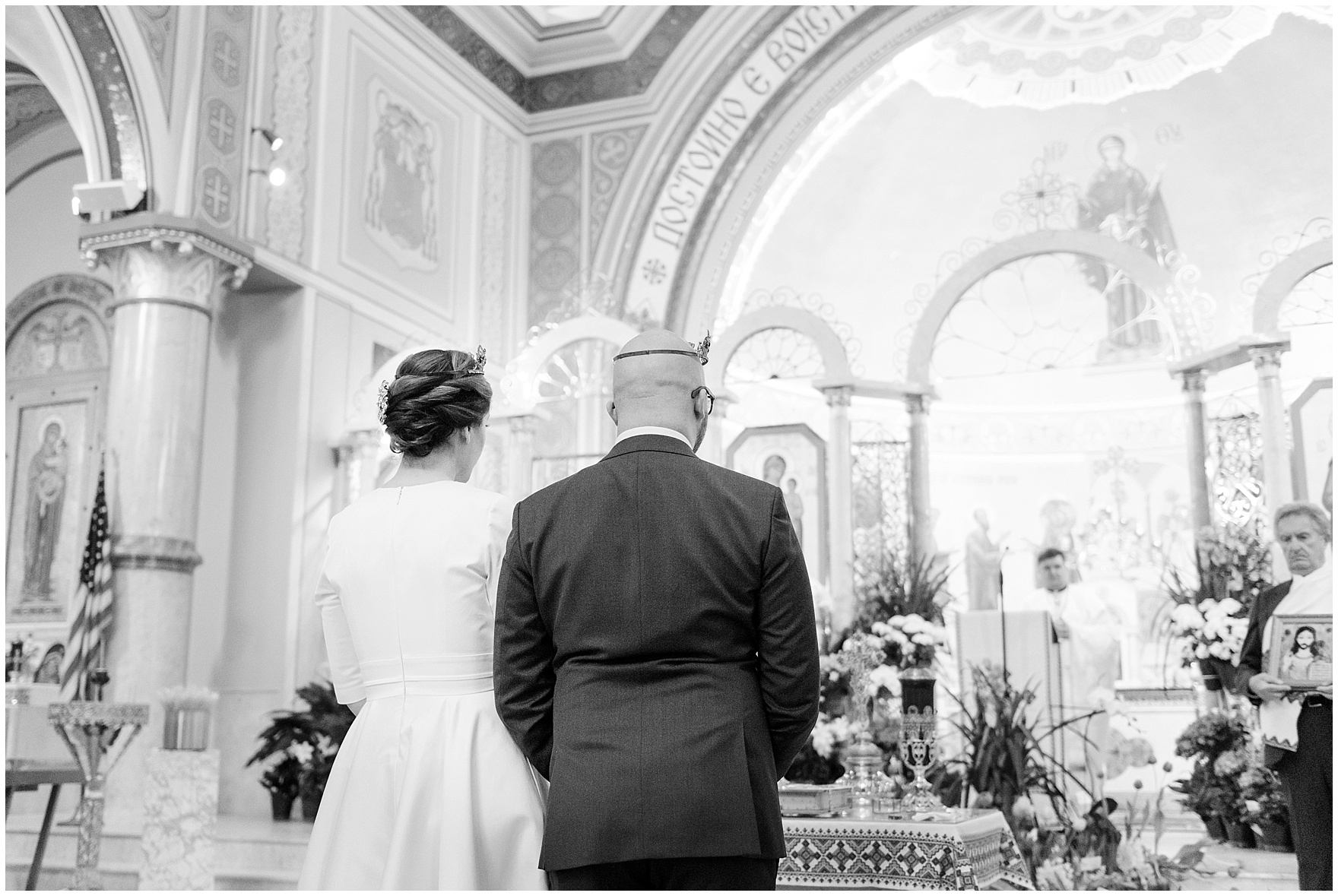 The bride and groom exchange vows, during a St. Nicholas Ukrainian Church and downtown Chicago East Bank Club wedding.