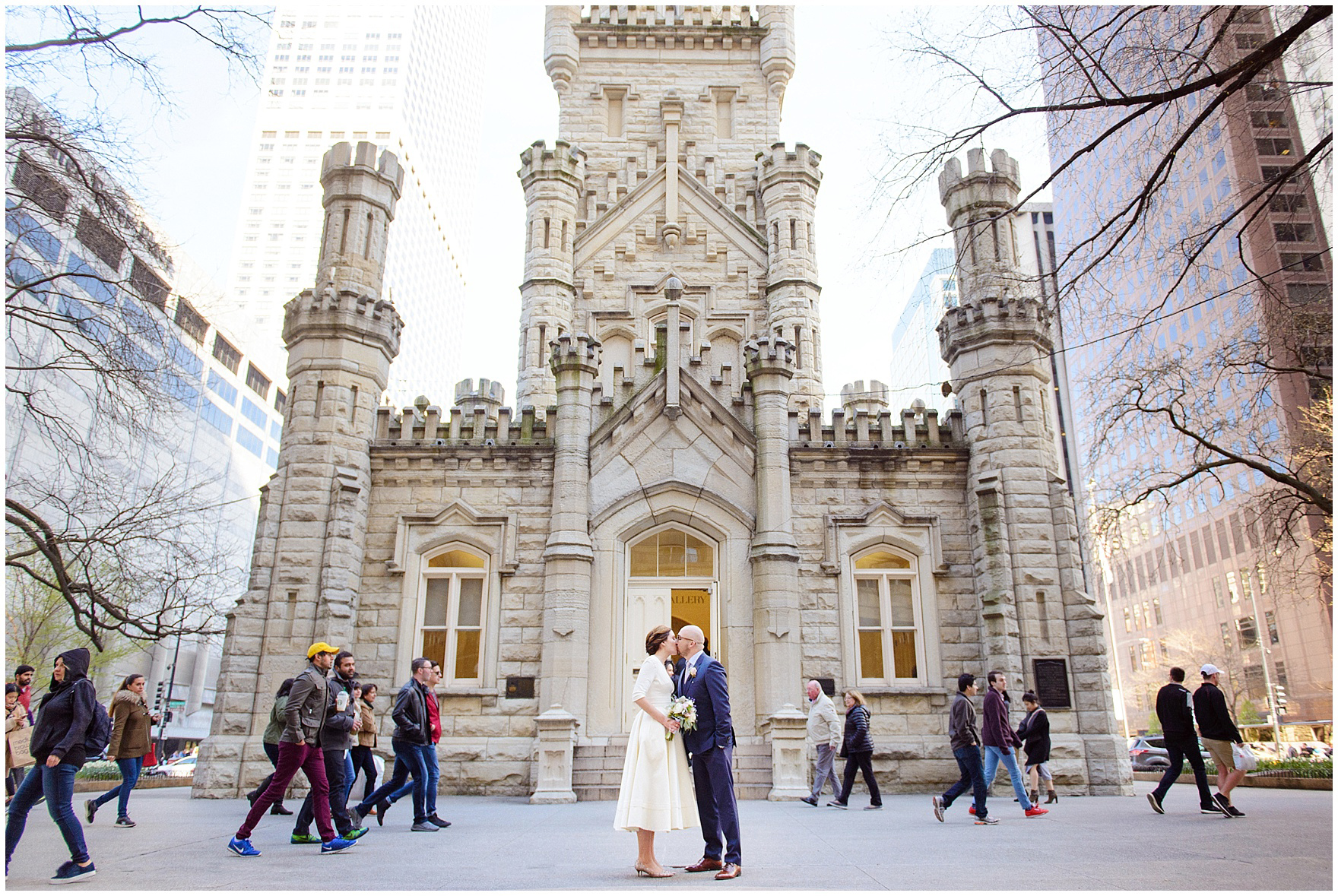 A bride and groom kiss at Water Tower Place, during their St. Nicholas Ukrainian Church and downtown Chicago East Bank Club wedding.