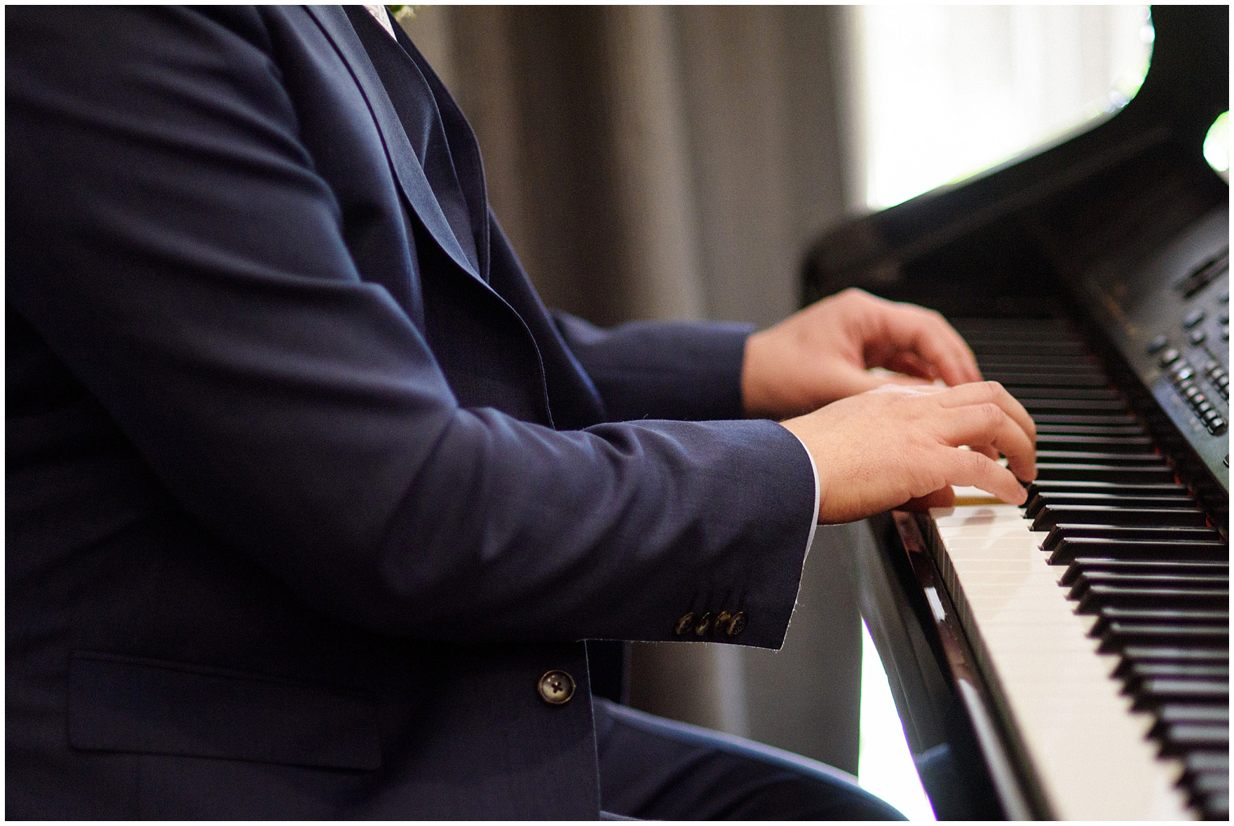 The groom plays piano at a reception for a St. Nicholas Ukrainian Church and downtown Chicago East Bank Club wedding.