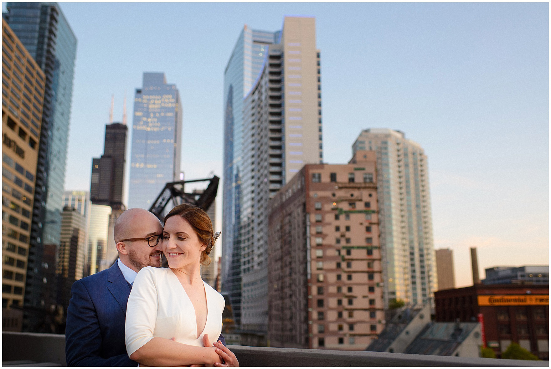The bride and groom pose in front of the Chicago skyline after their St. Nicholas Ukrainian Church and downtown Chicago East Bank Club wedding.