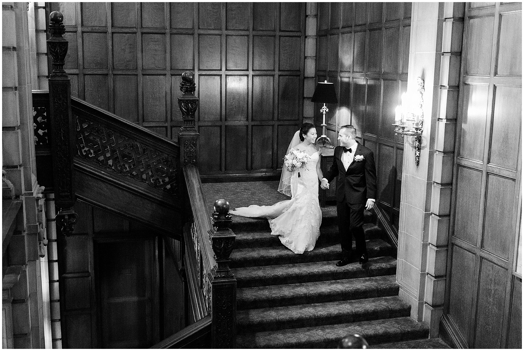 The bride and groom share their first look on the grand staircase at a University Club of Chicago wedding.