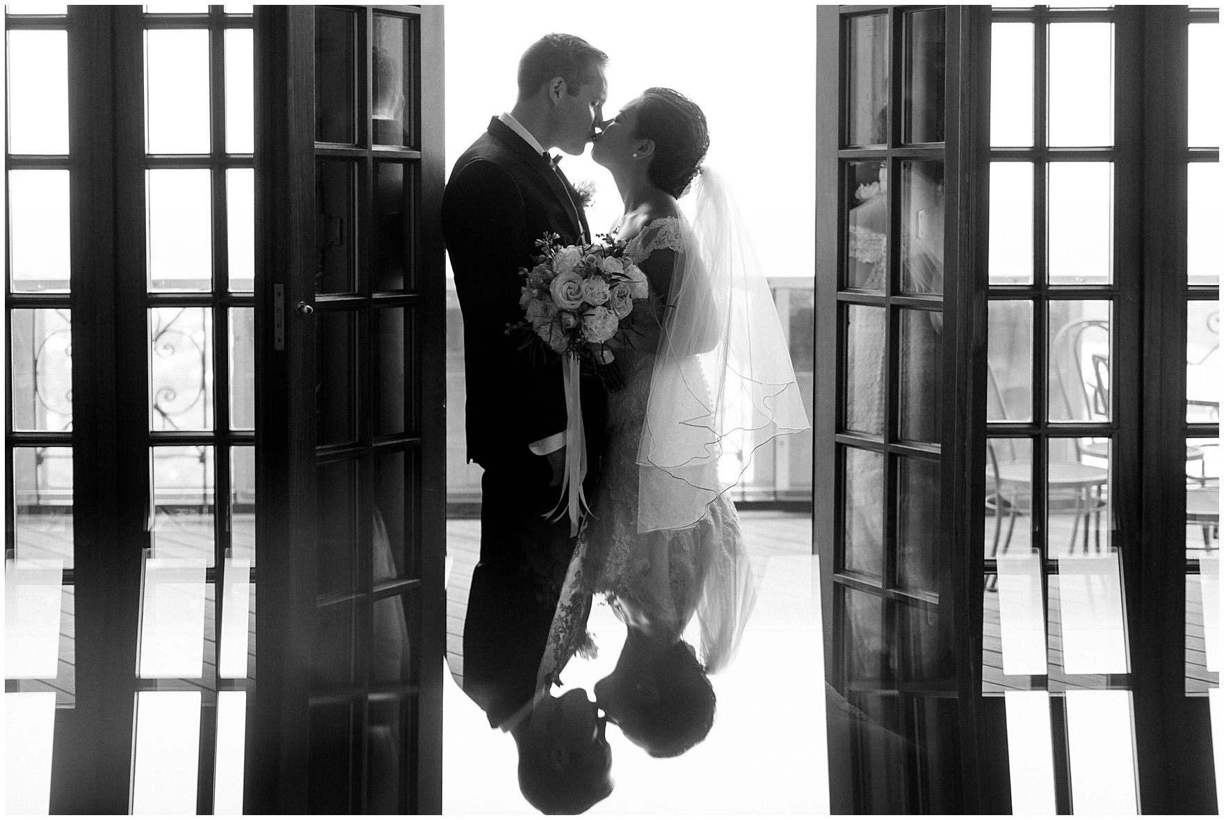The bride and groom kiss on the terrace before their University Club of Chicago wedding.