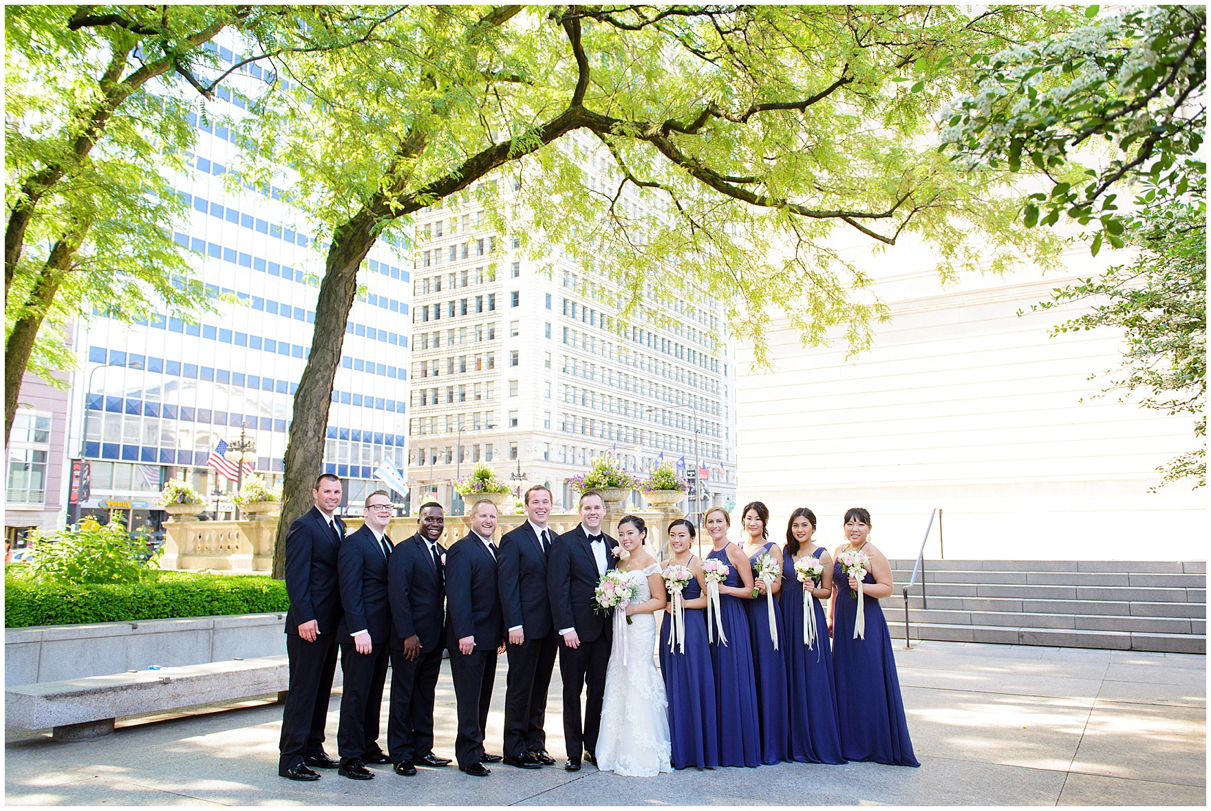A bridal party poses in the South Gardens of the Art Institute of Chicago before a University Club of Chicago wedding.