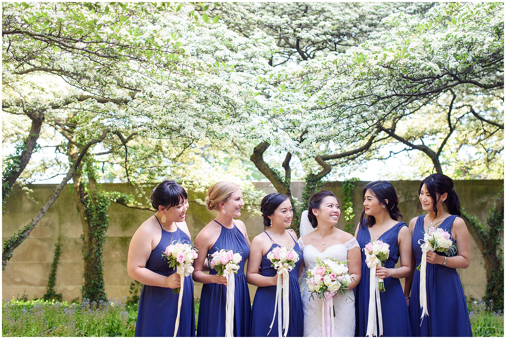 Bridesmaids pose in the South Gardens of the Art Institute of Chicago before a University Club of Chicago wedding.
