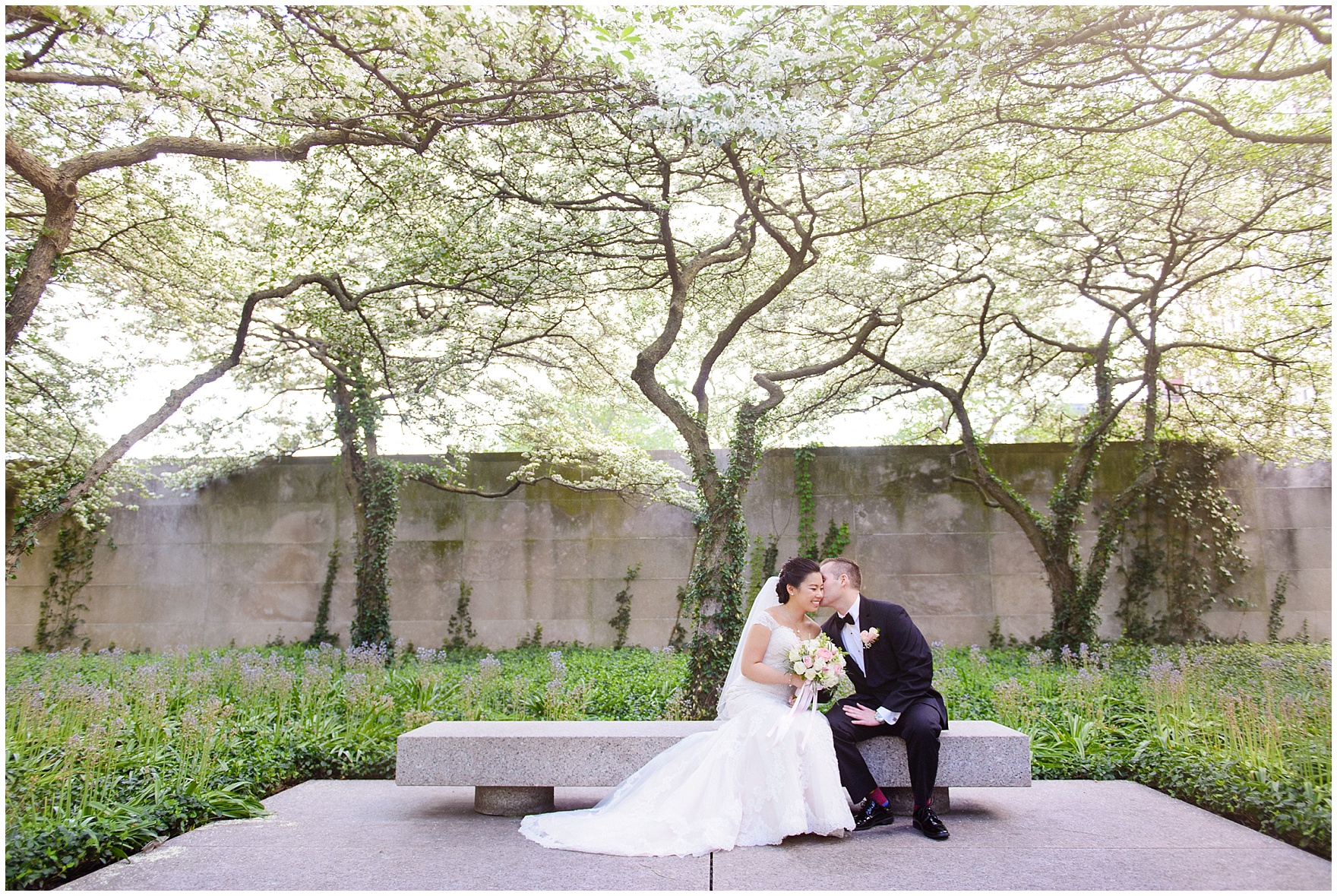 A bride and groom pose in the South Gardens of the Art Institute of Chicago before a University Club of Chicago wedding.