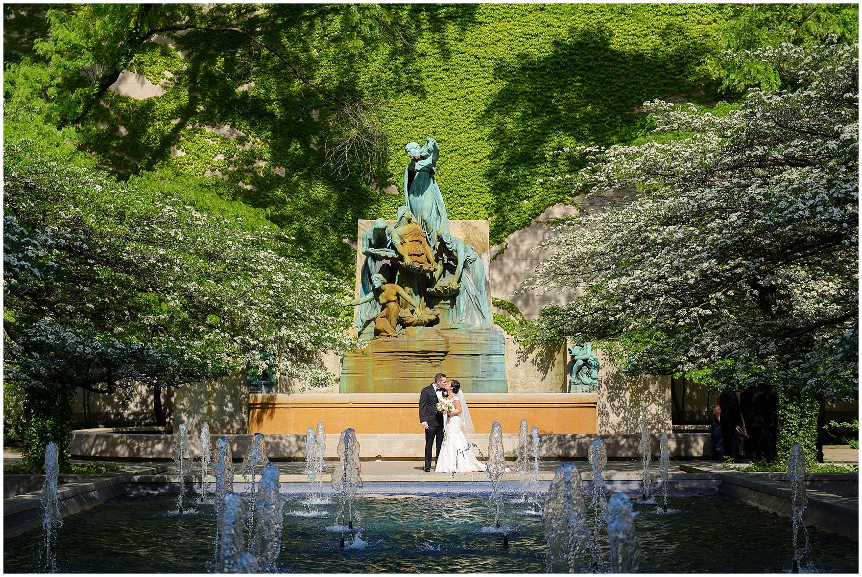 A bride and groom pose in the Art Institute gardens before a University Club of Chicago wedding.