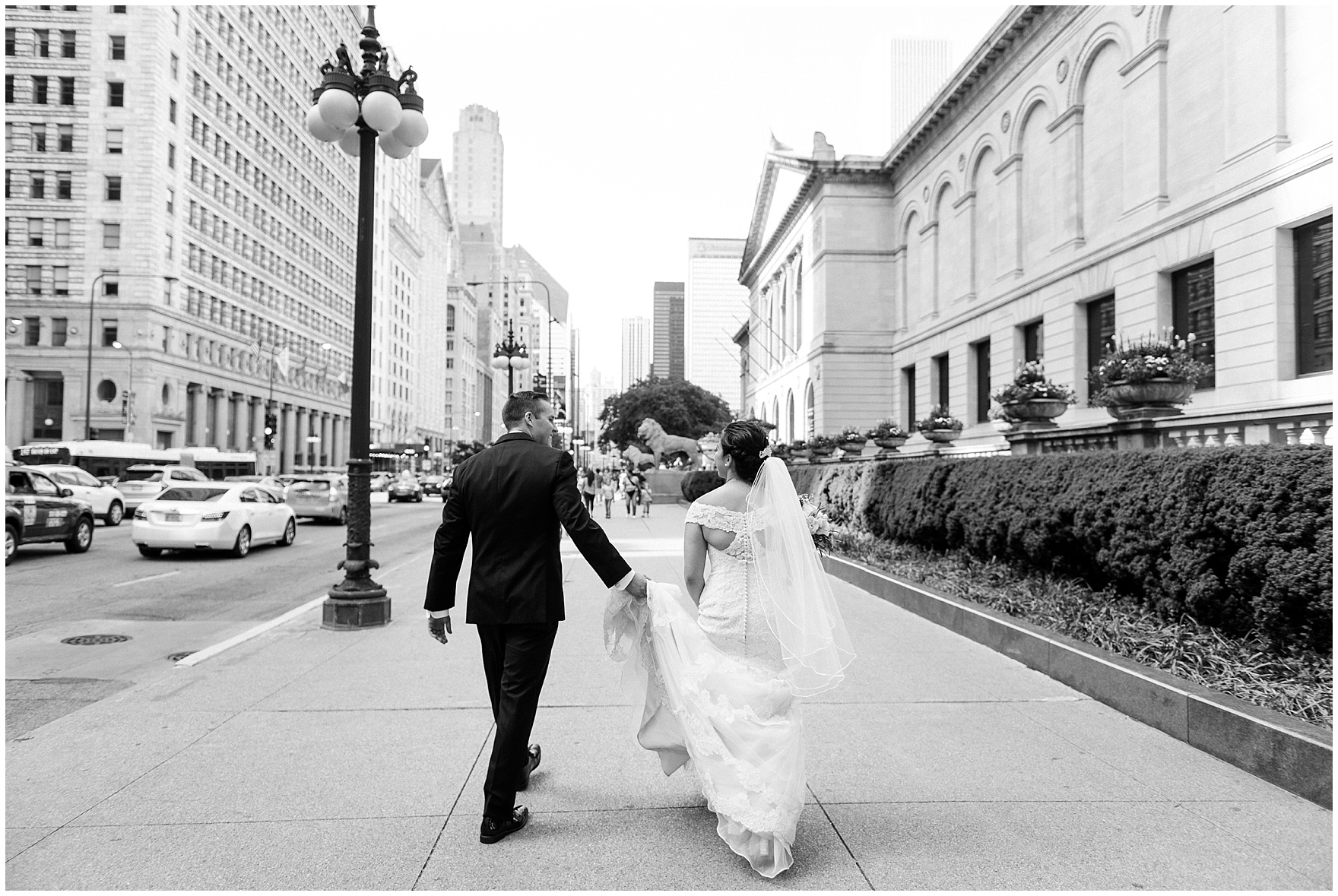 A bride and groom walk along Michigan Avenue before a University Club of Chicago wedding.