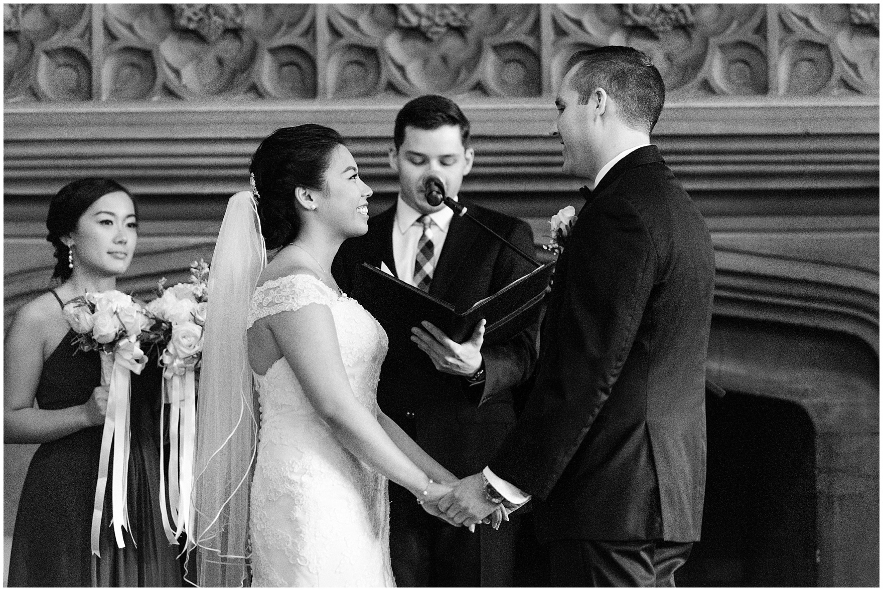 A bride and groom exchange vows in the Michigan Room during a University Club of Chicago wedding.