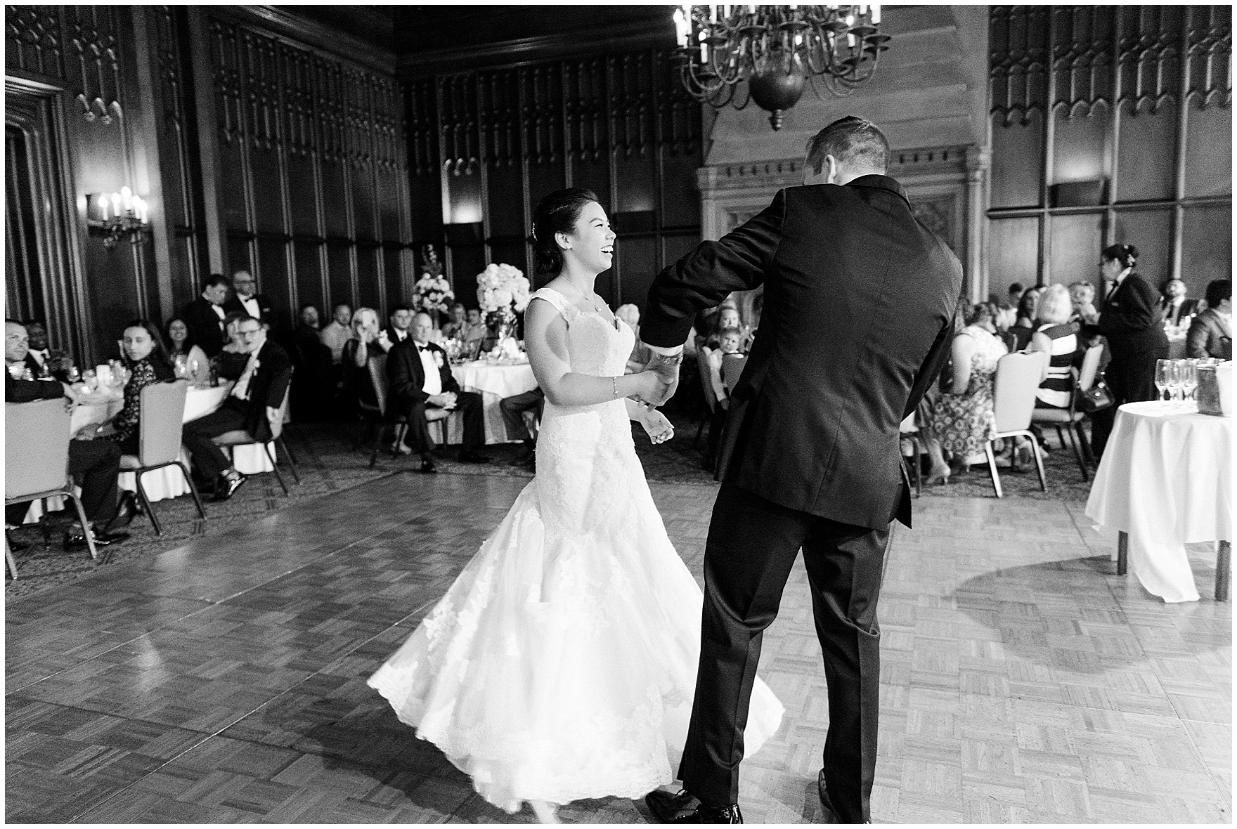 A bride and groom share their first dance in the Michigan Room set up for a dinner reception for a University Club of Chicago wedding.