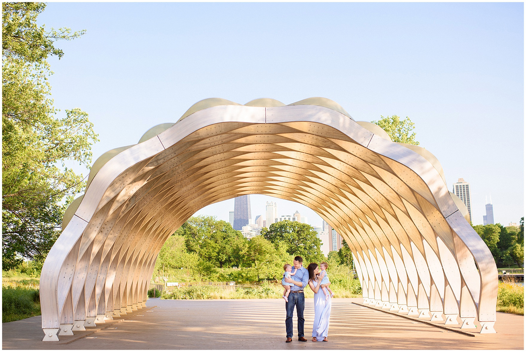 A family stands beneath the honeycomb during a Chicago Lincoln Park family photography session.