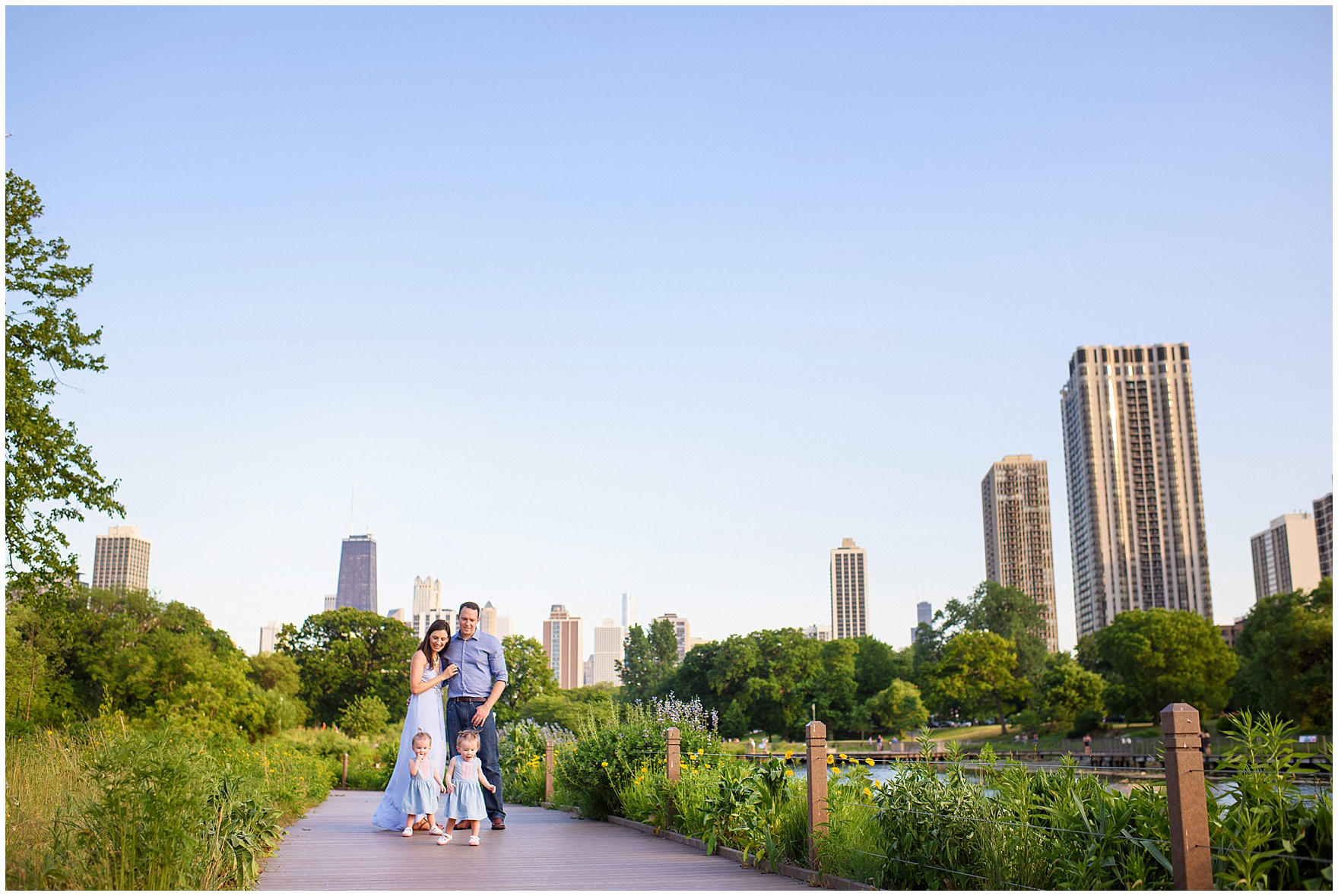 A family walks along the Nature Boardwalk during a Chicago Lincoln Park family photography session.