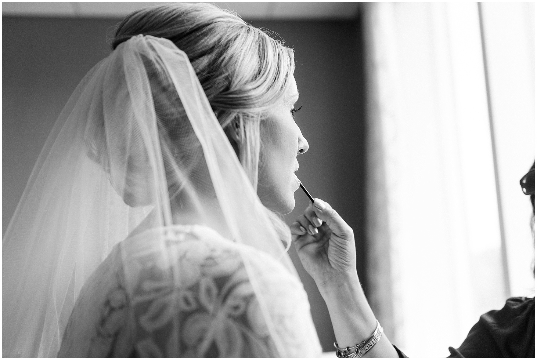 Black and white behind the scenes photo of a bride getting ready for an Itasca Country Club Illinois wedding.