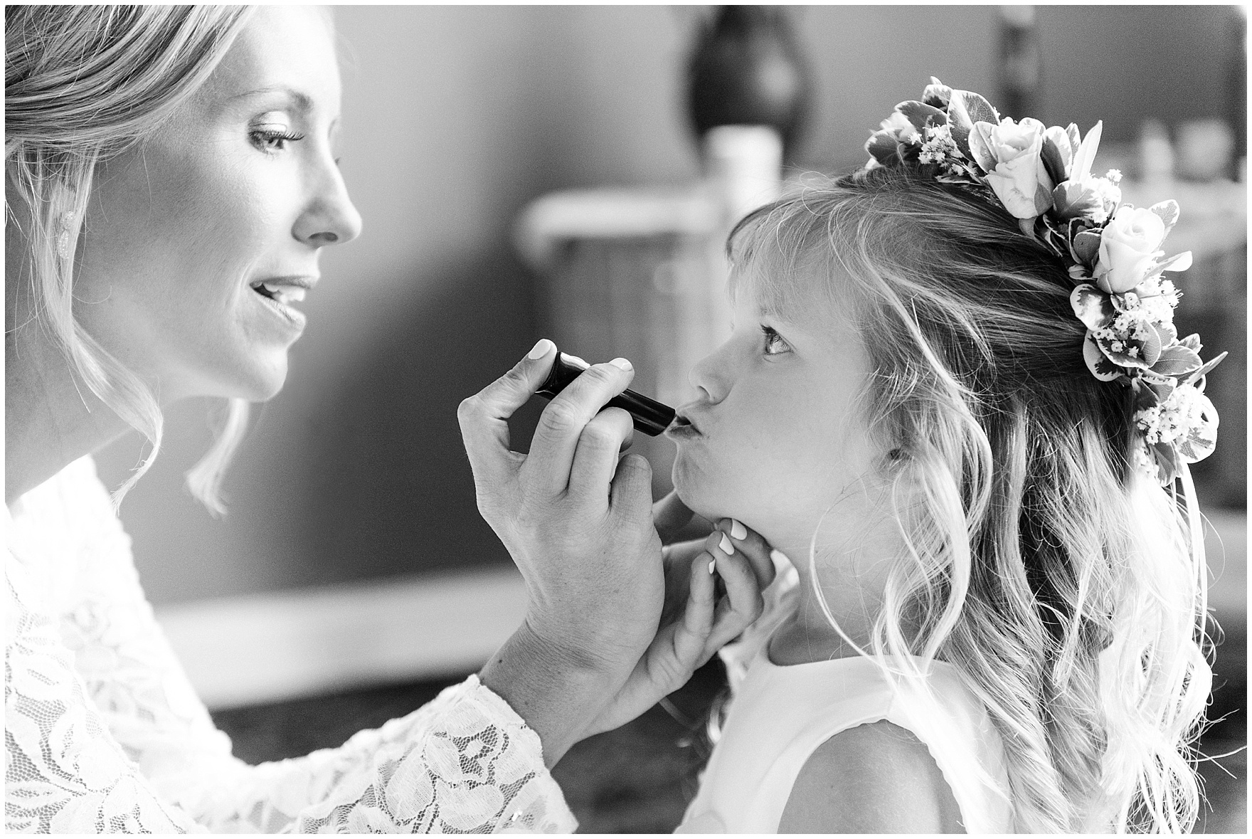 A bride helps the flowergirl with some lipgloss for an Itasca Country Club Illinois wedding.