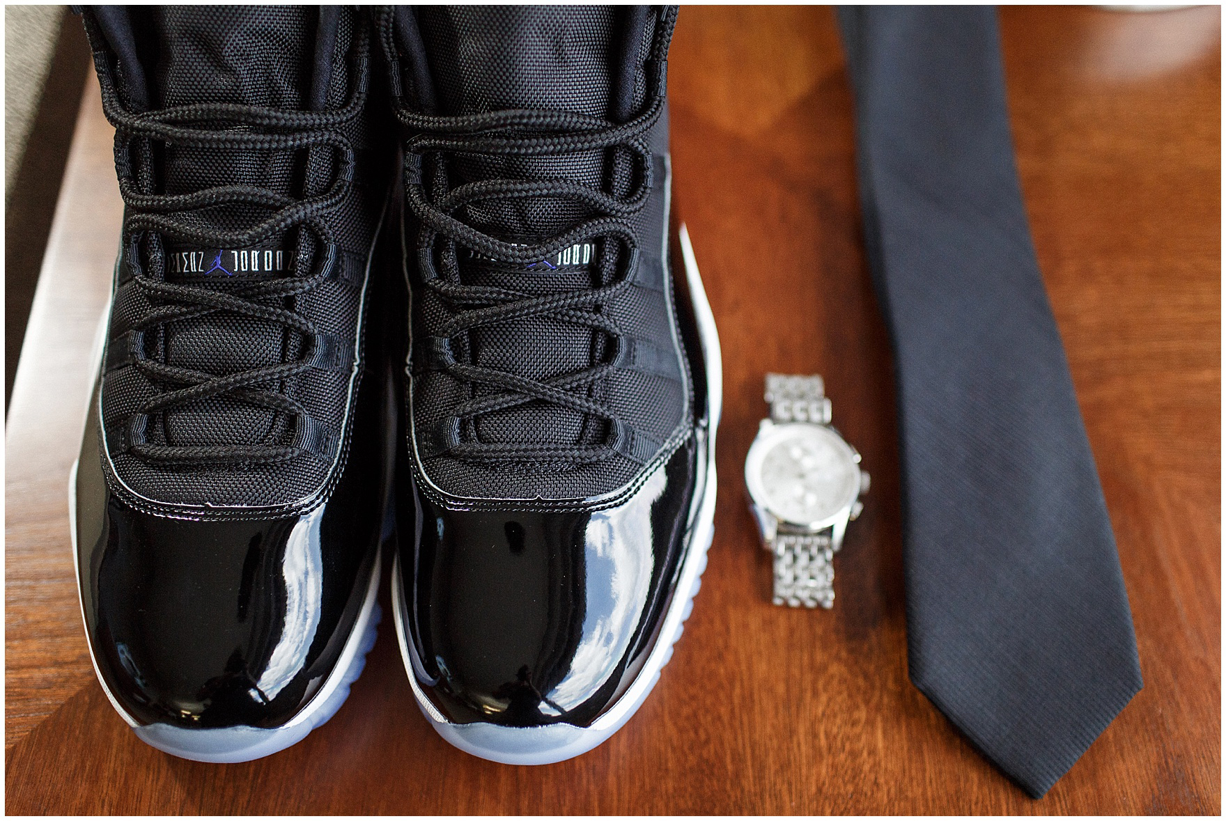 Details of the groom's Jordans, watch and tie for an Itasca Country Club Illinois wedding.