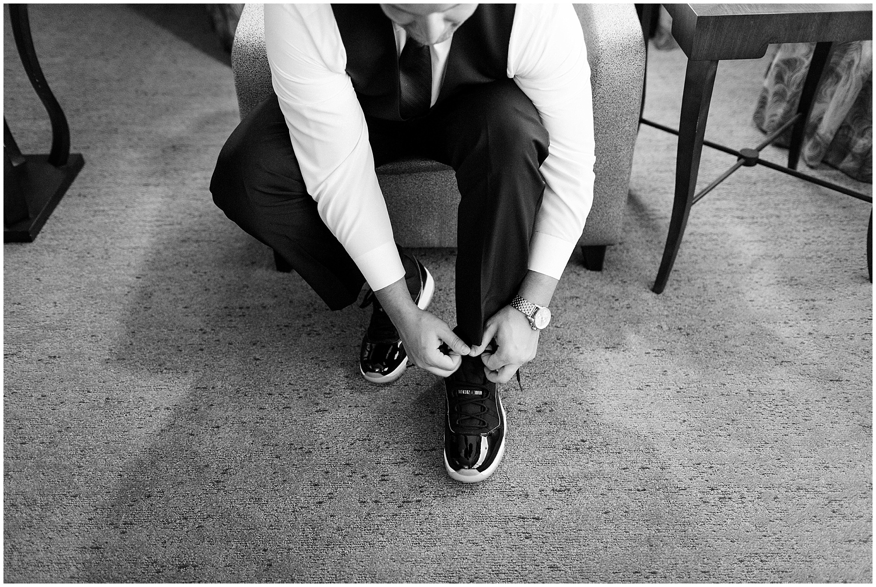 The groom ties his Jordan sneakers for an Itasca Country Club Illinois wedding.