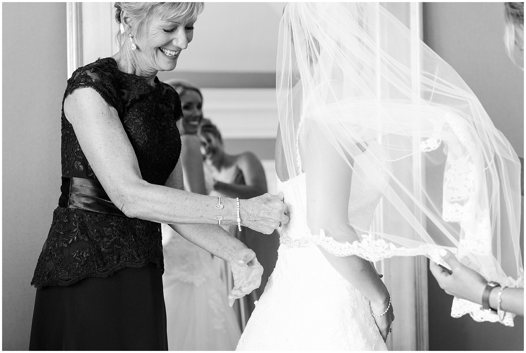 The bride's mother zips her wedding dress for an Itasca Country Club Illinois wedding.