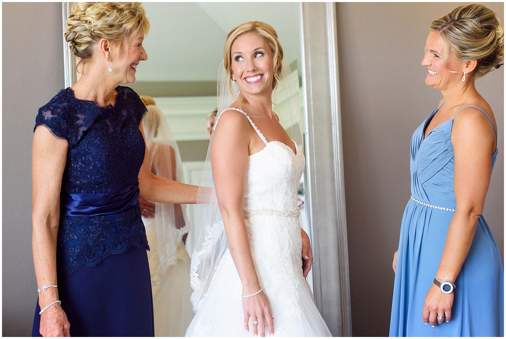 The bride smiles at her mother and sister before an Itasca Country Club Illinois wedding.