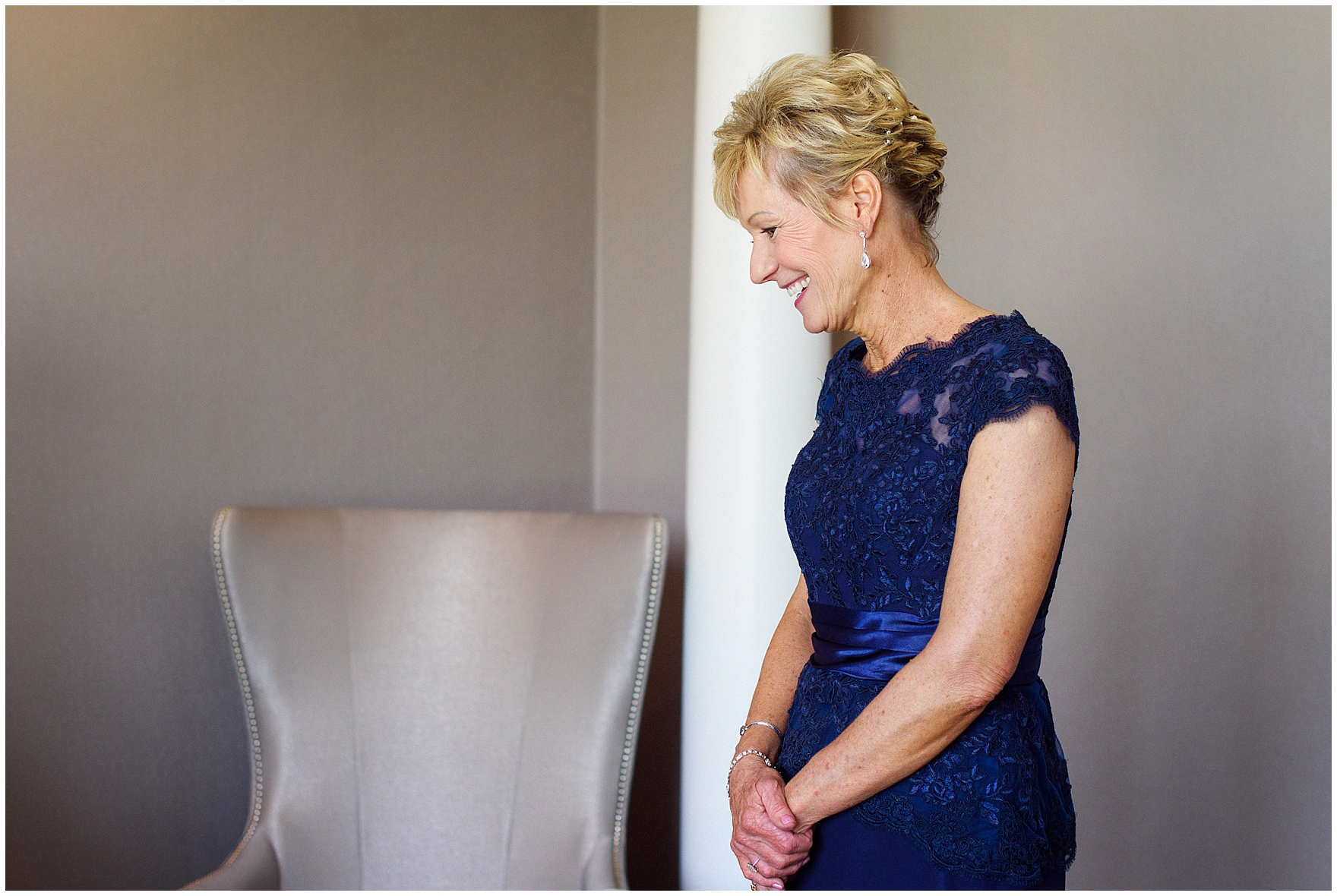 The bride's mother laughs while getting ready for an Itasca Country Club Illinois wedding.