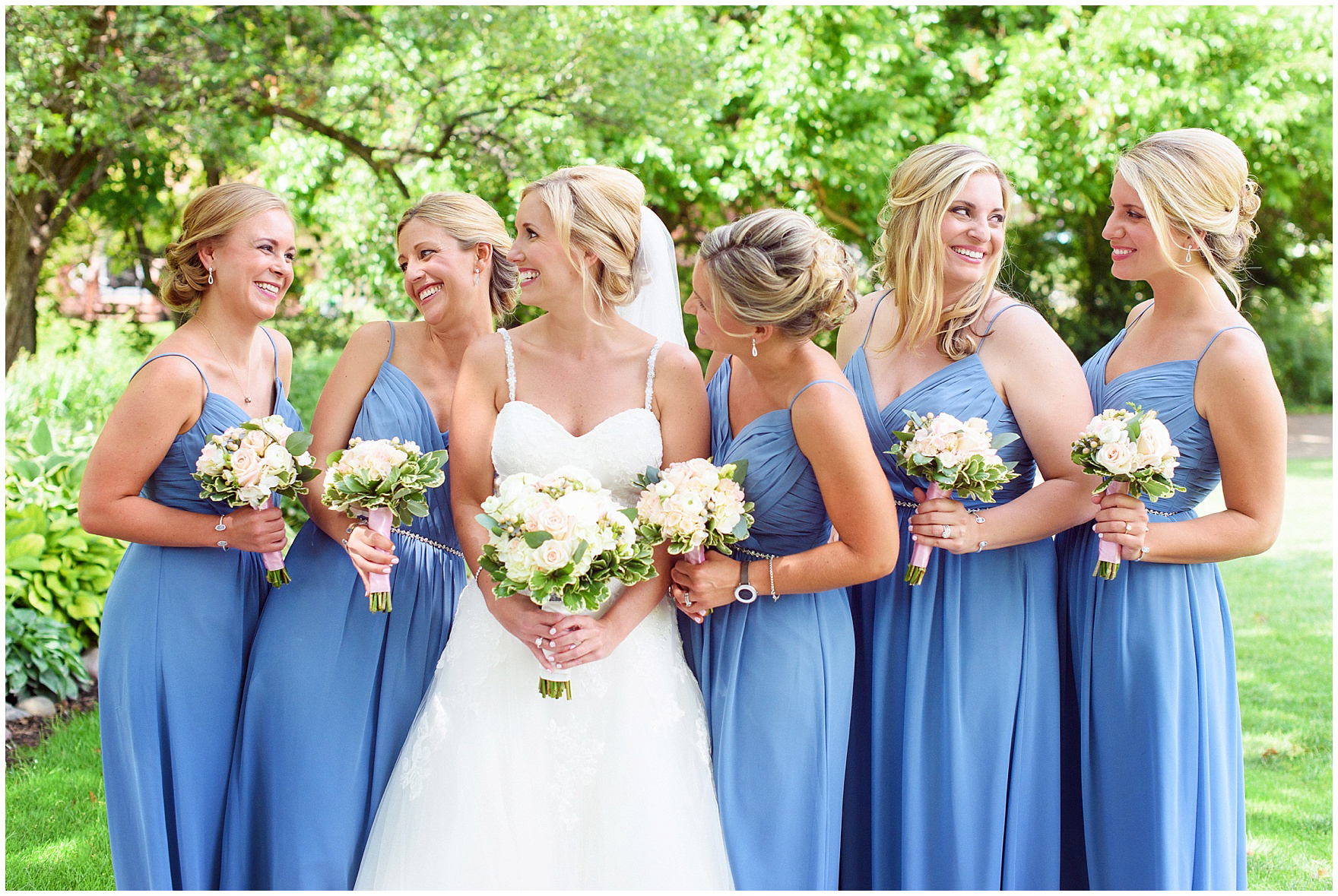 Bridesmaids in periwinkle blue laugh during an Itasca Country Club Illinois wedding.
