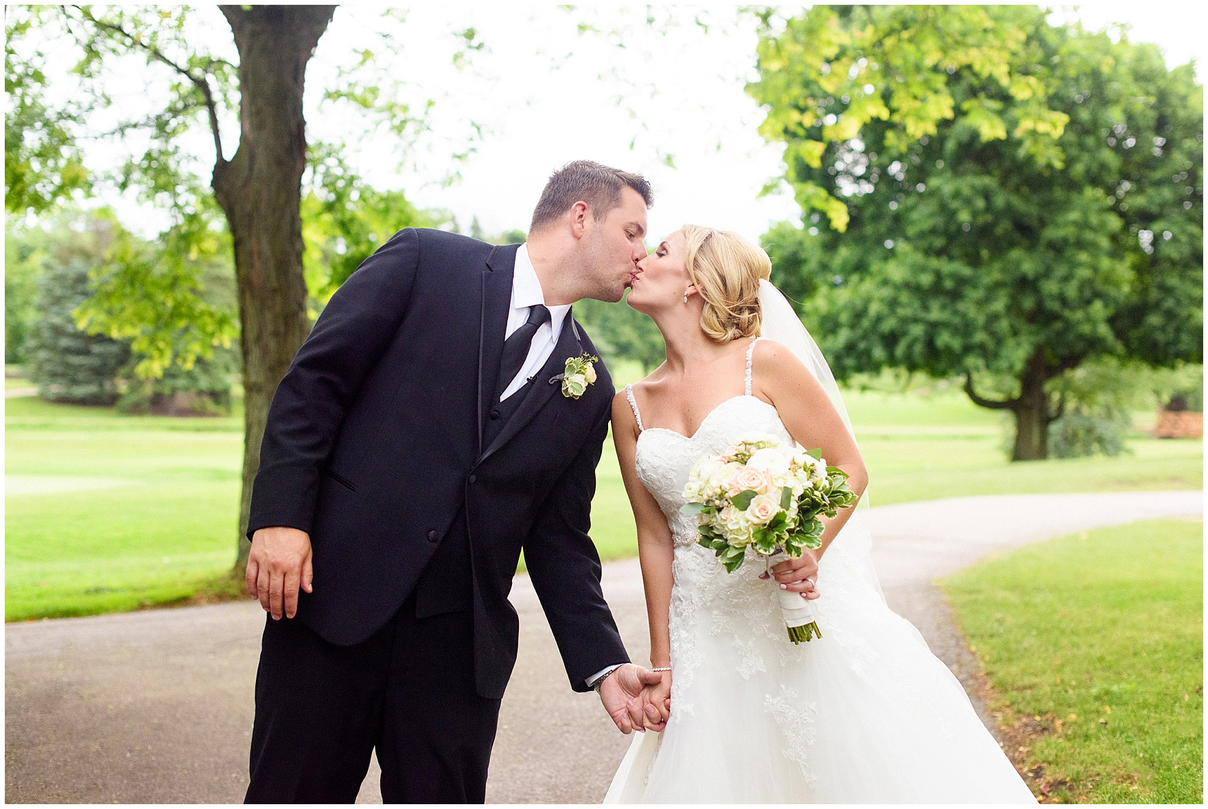 A bride and groom kiss during their Itasca Country Club Illinois wedding.