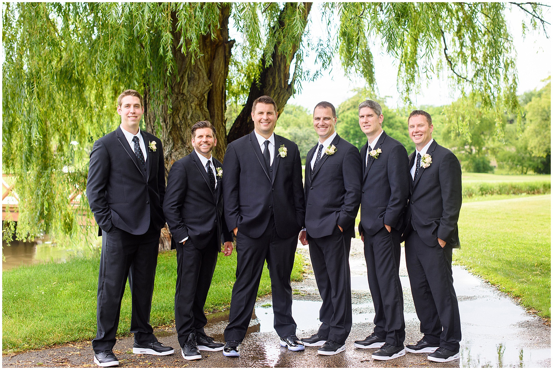 Groomsmen pose during an Itasca Country Club Illinois wedding.