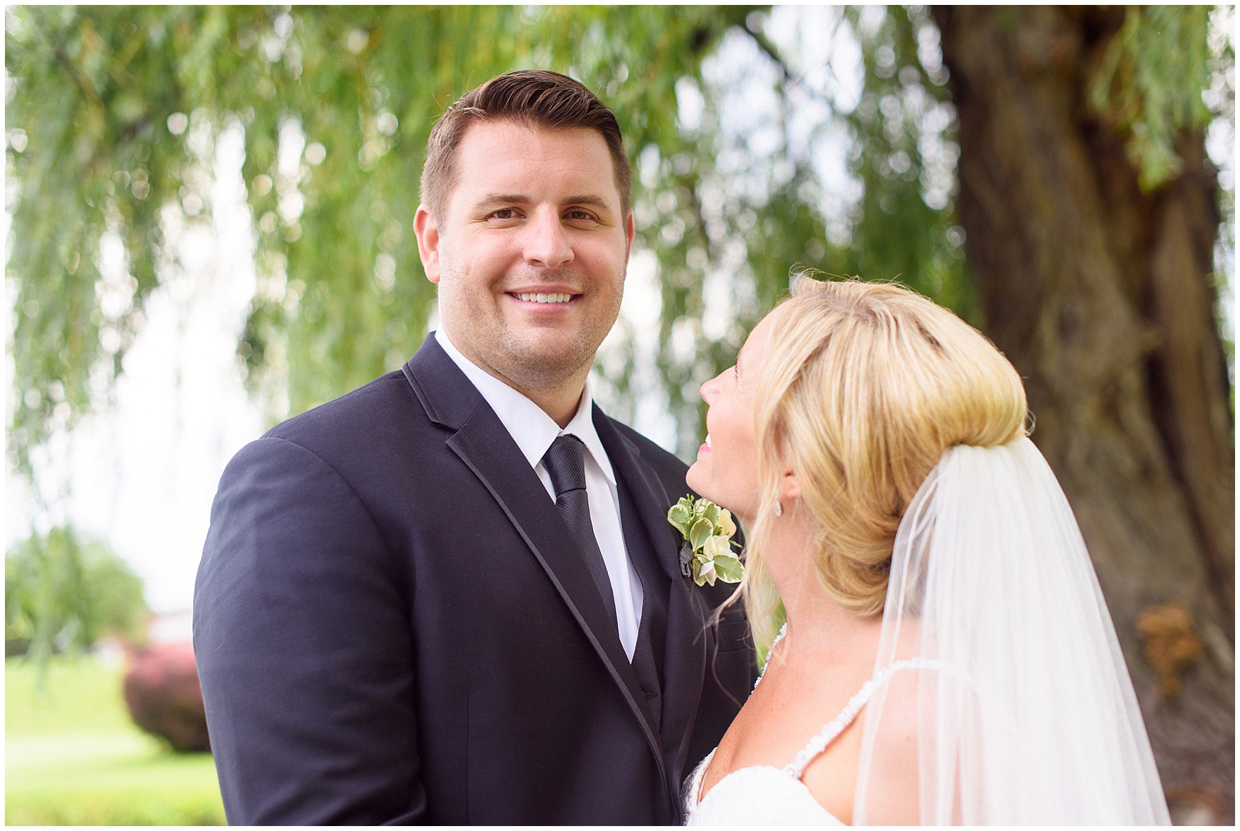 A groom smiles at his Itasca Country Club Illinois wedding.