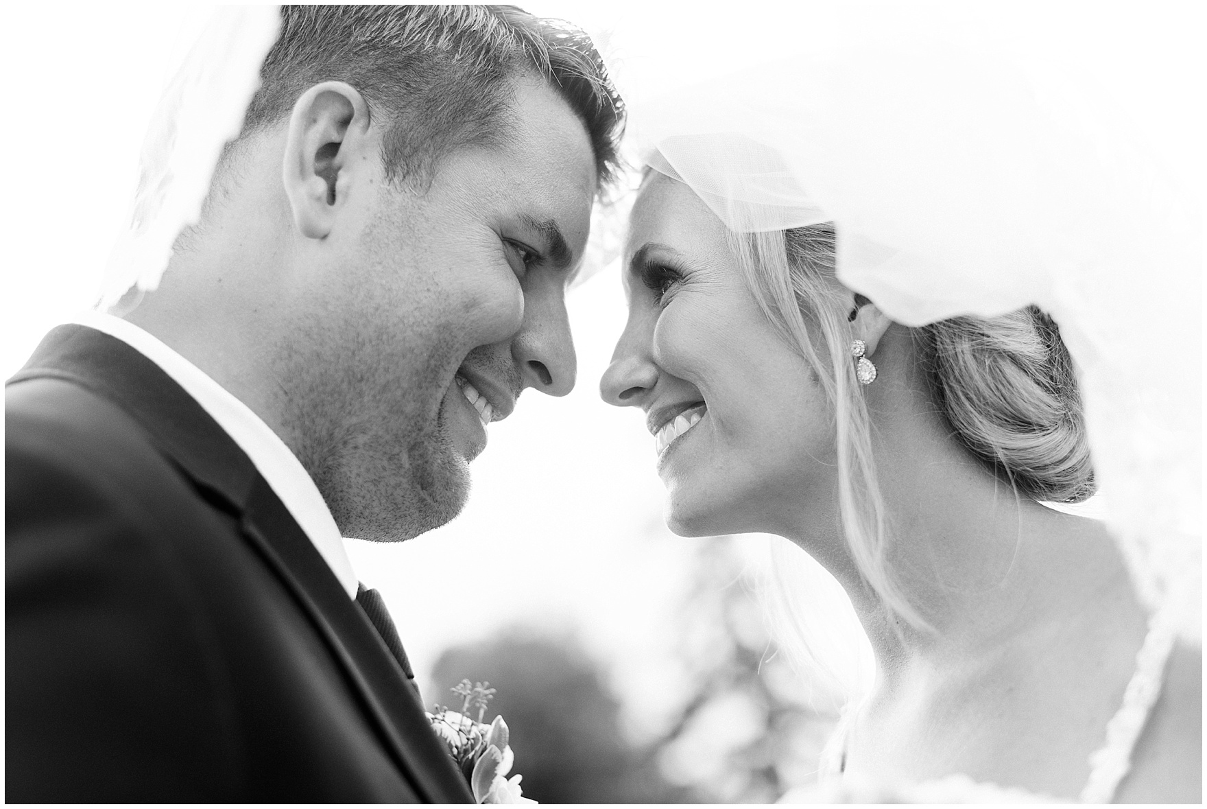 A bride and groom smile at each other during their Itasca Country Club Illinois wedding.