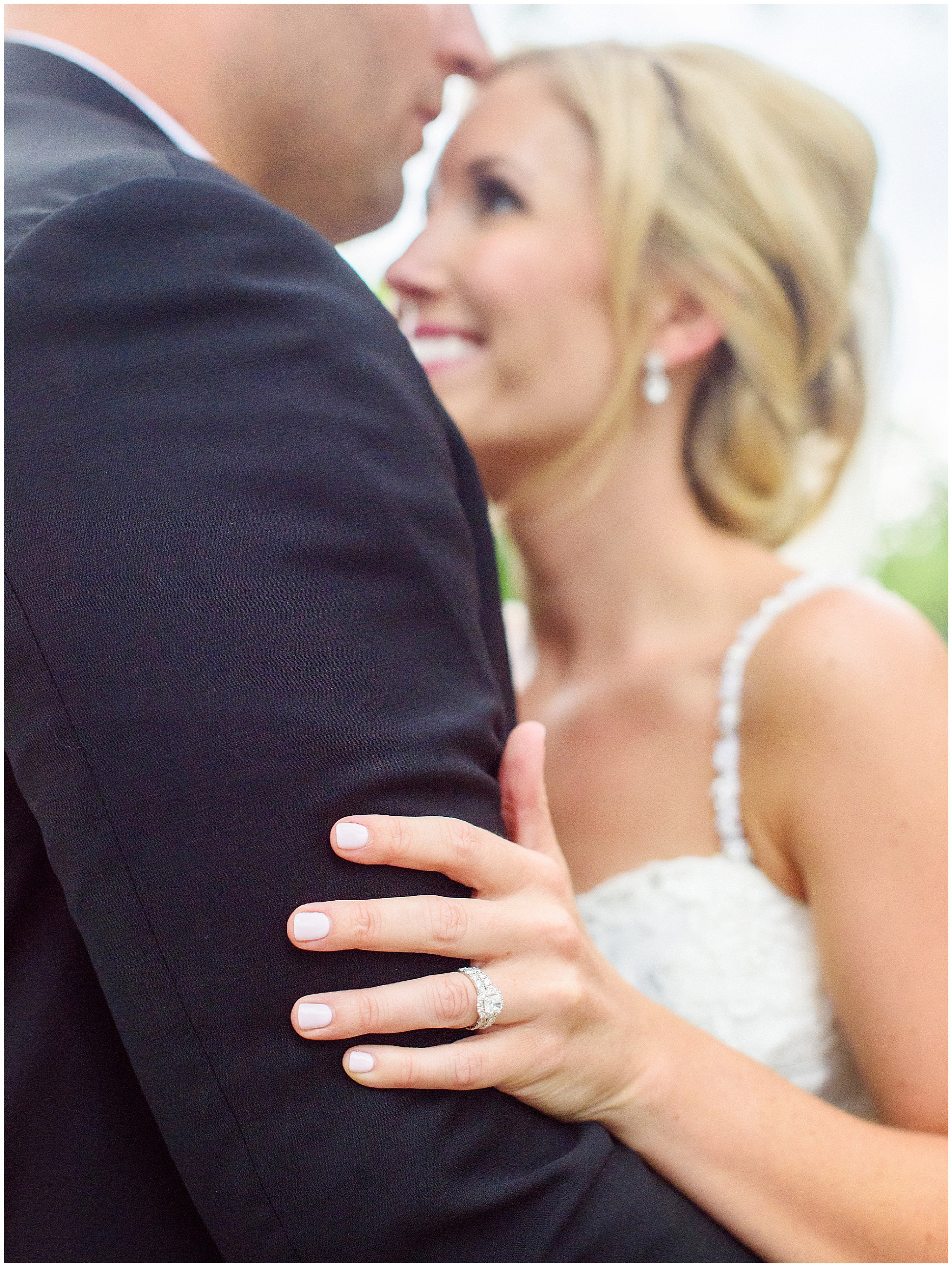 A bride and groom embrace during their Itasca Country Club Illinois wedding.