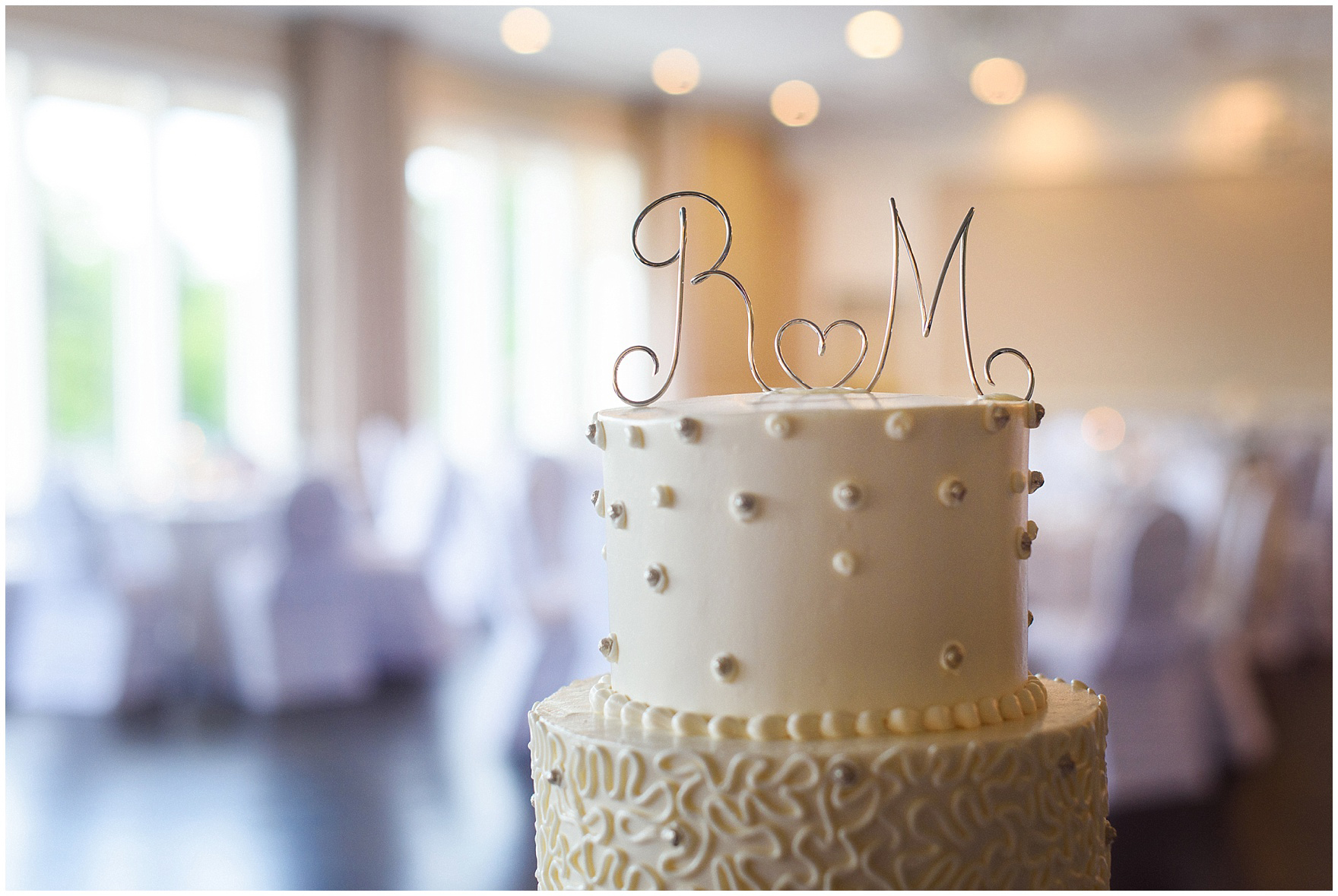 Detail of a cake topper on a wedding cake by Oak Mills Bakery for an Itasca Country Club Illinois wedding.