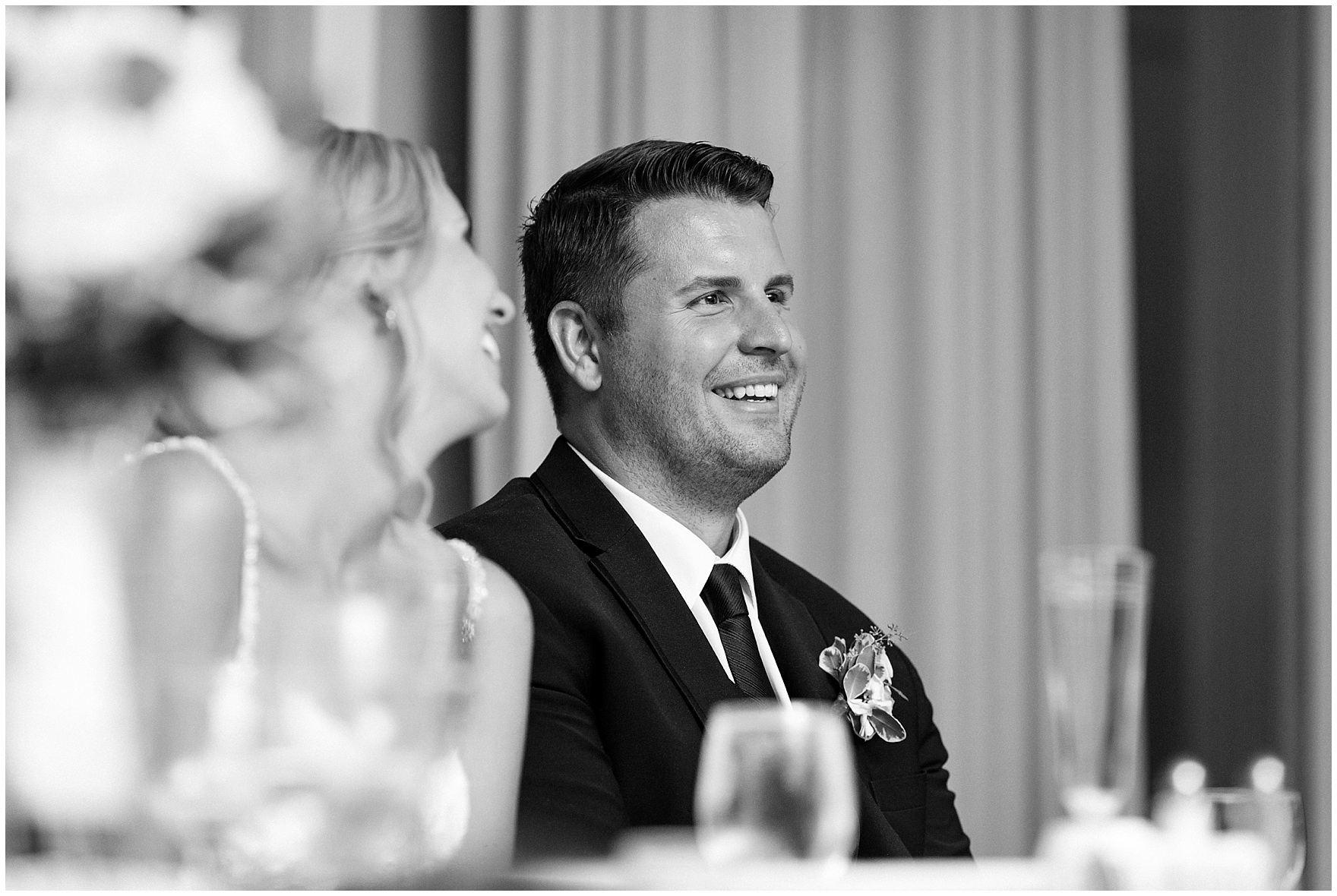 The groom listens to the best man's toast at an Itasca Country Club Illinois wedding.