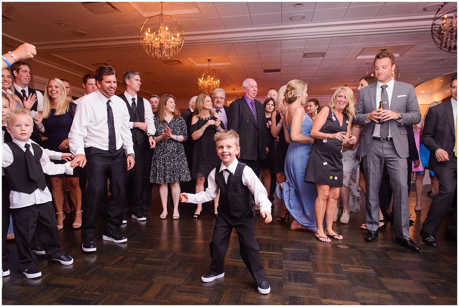 A ring bearer dances at an Itasca Country Club Illinois wedding.