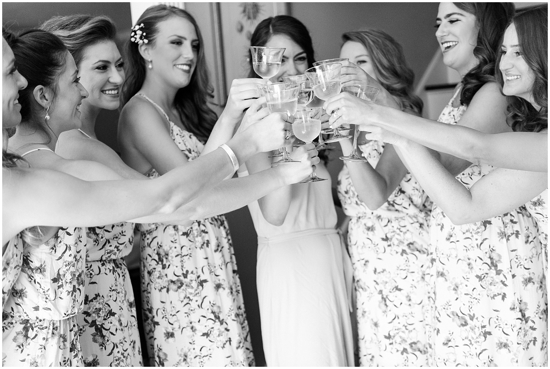 A bride and her bridesmaids toast before a Biltmore Country Club Barrington wedding.
