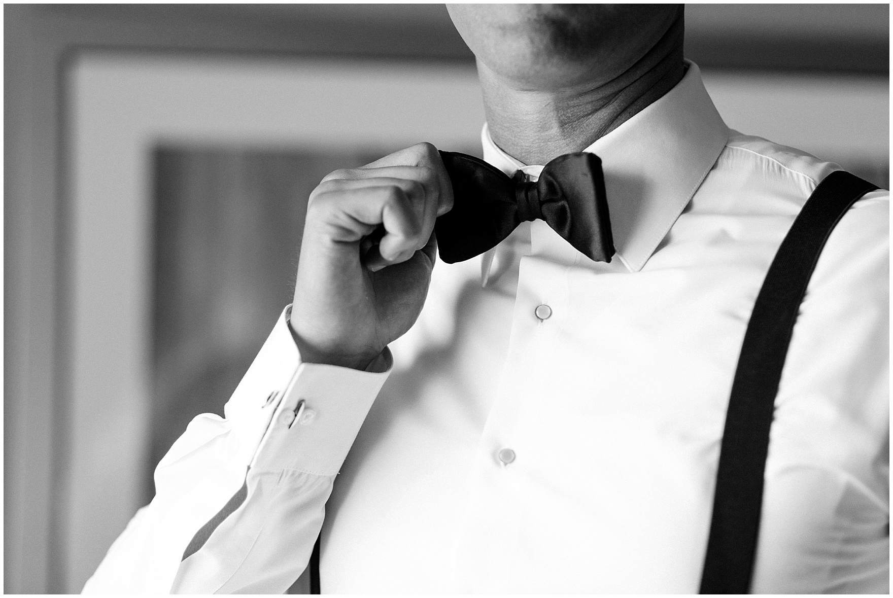 The groom adjusts his bow tie before a Biltmore Country Club Barrington wedding.