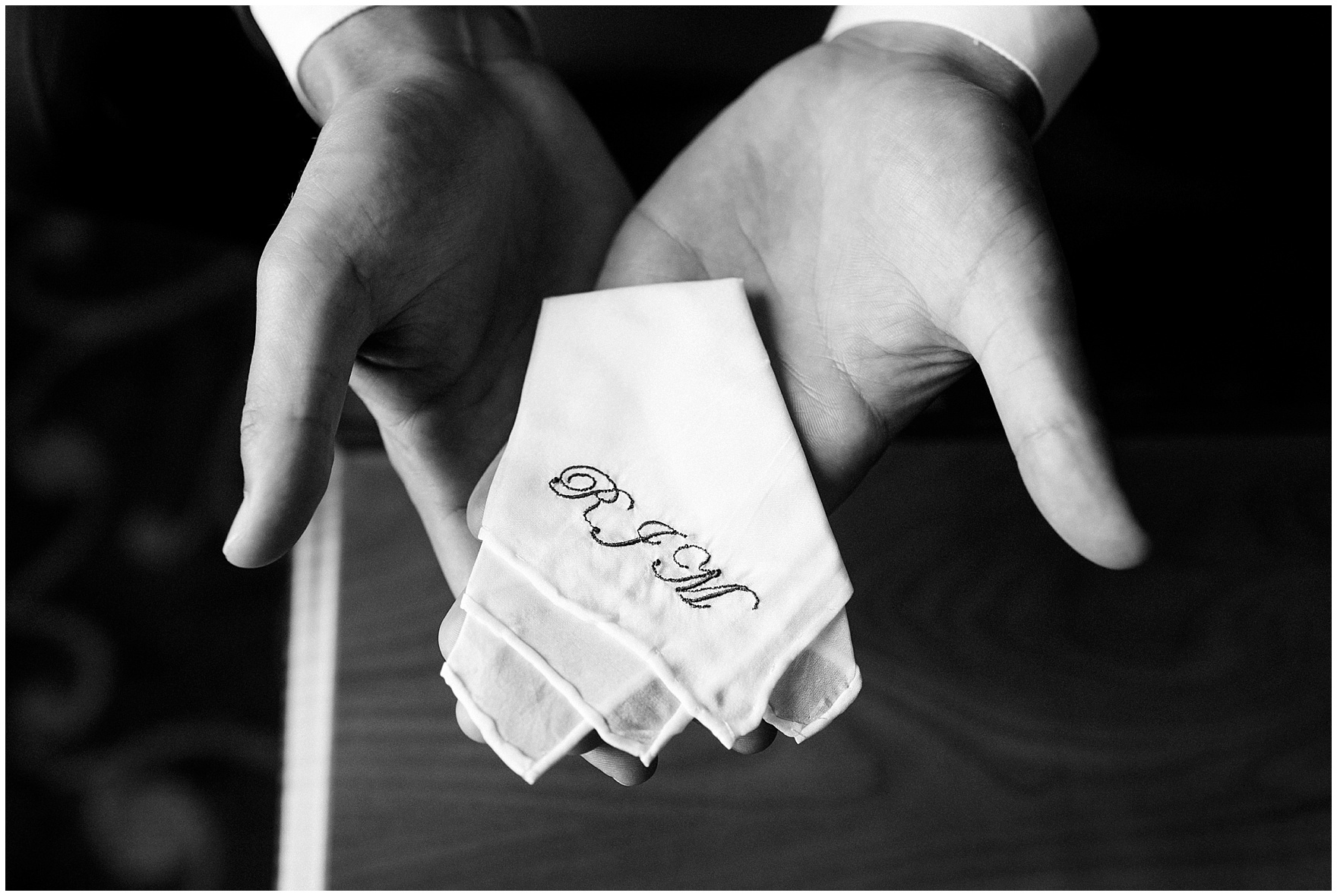 The groom holds a monogrammed handkerchief that he'll carry on his wedding day, for a Biltmore Country Club Barrington wedding.