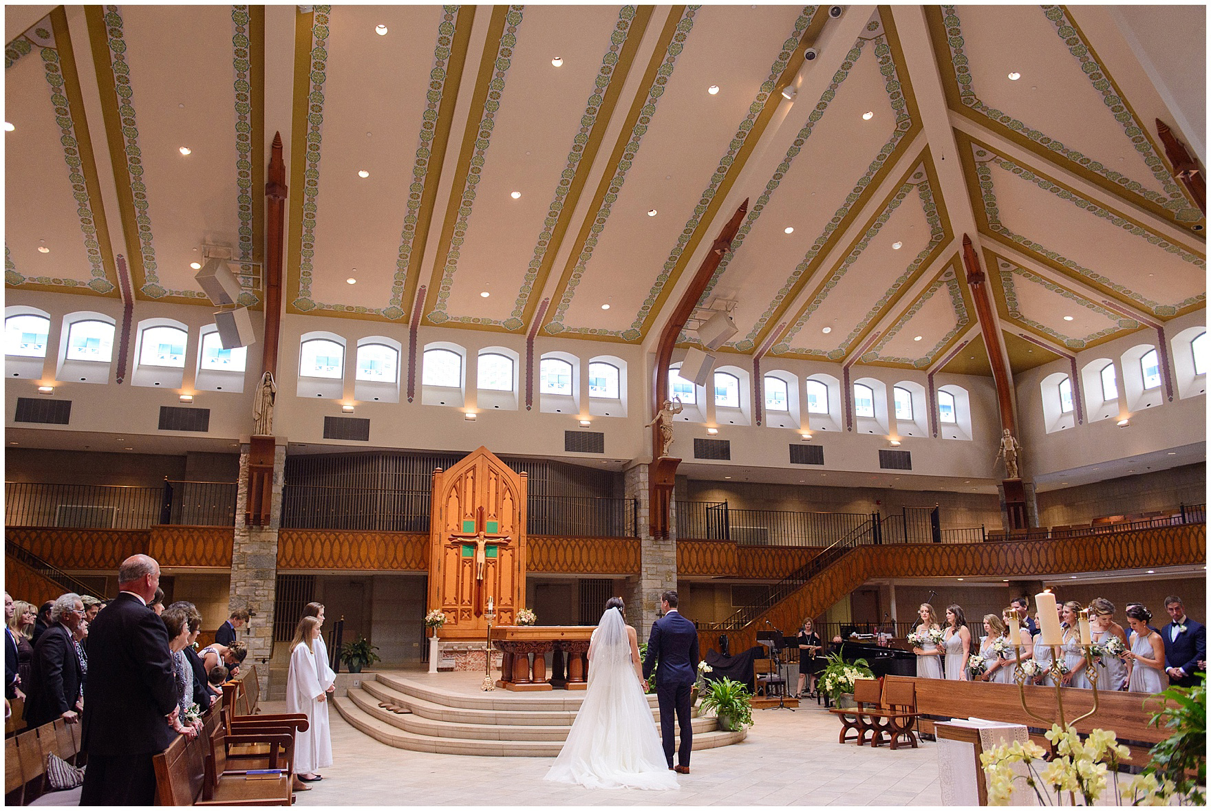 A wedding ceremony at St. Anne's Catholic Community, for a Biltmore Country Club Barrington wedding.