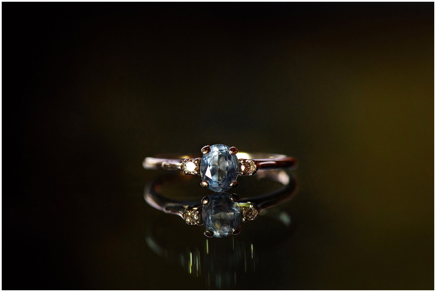 Macro shot of a vintage sapphire ring worn by the bride at a Biltmore Country Club Barrington wedding.