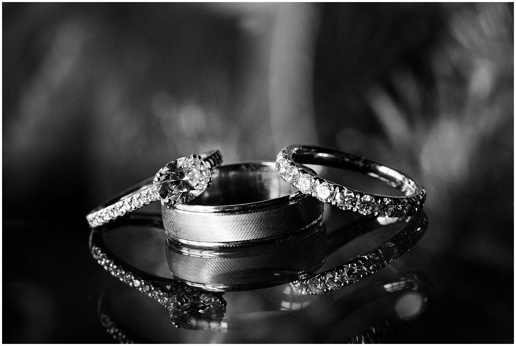 Black and white detail shot of wedding bands and a diamond engagement ring during a Biltmore Country Club Barrington wedding.