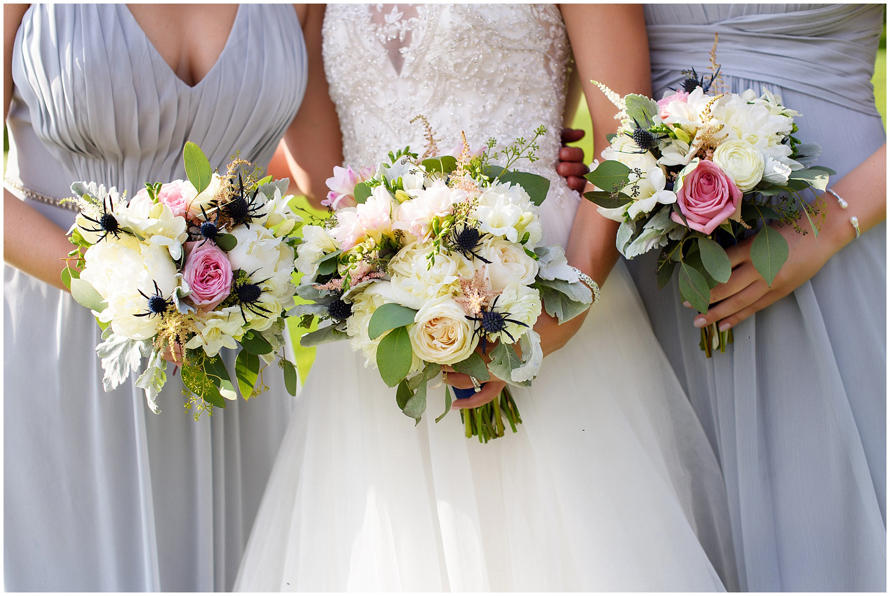 Details of a bridal bouquet and bridesmaids bouquets during a Biltmore Country Club Barrington wedding.