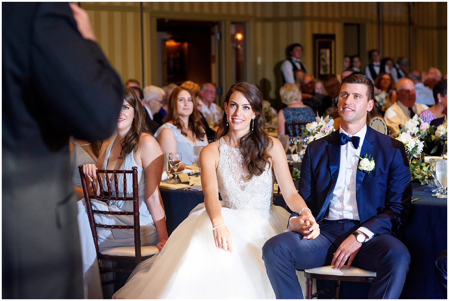 The bride and groom listen to speeches during a Biltmore Country Club Barrington wedding.