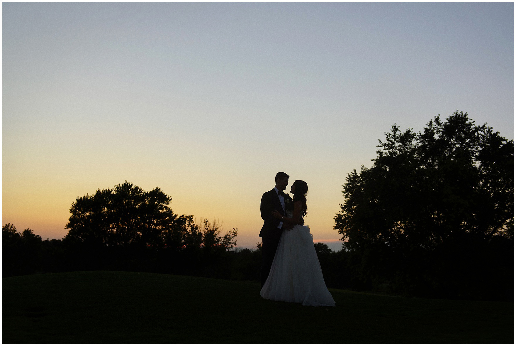 A bride and groom pose at sunset during a Biltmore Country Club Barrington wedding.