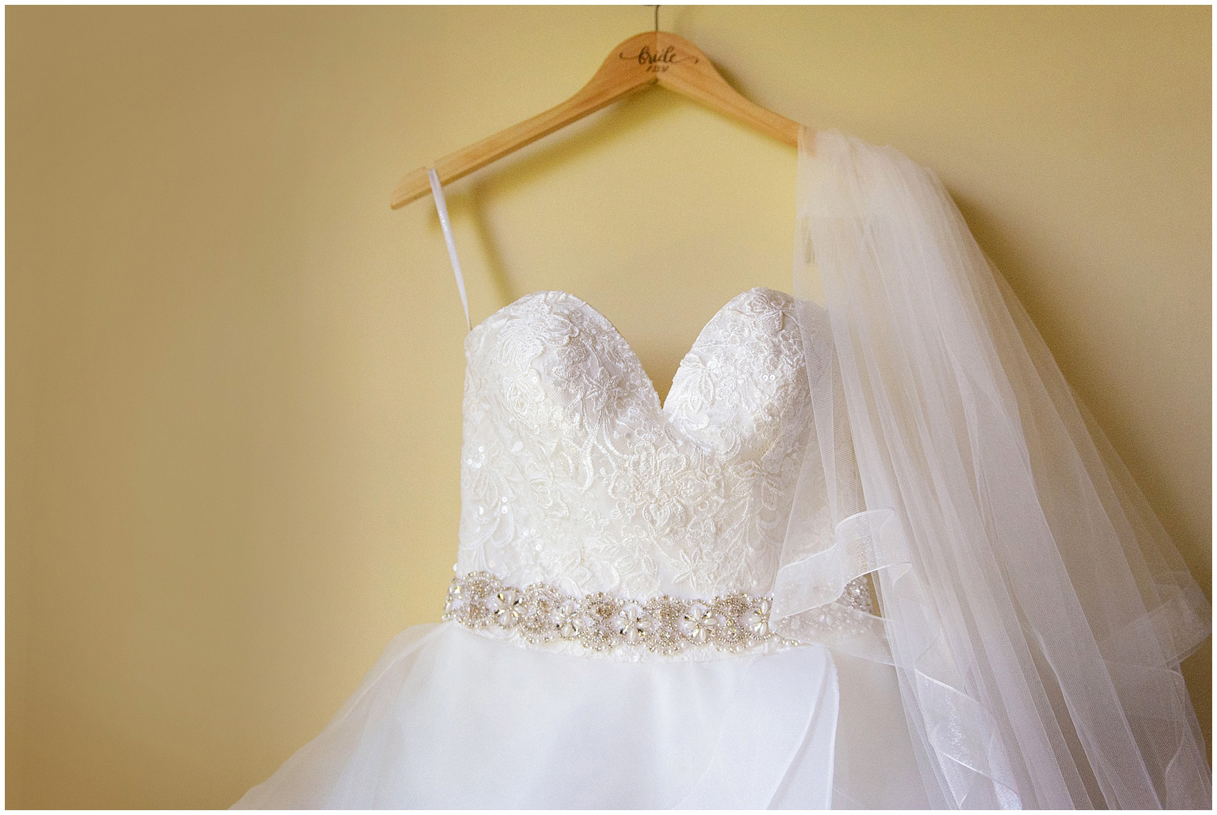 The bridal gown hangs at the Morris Inn before a University of Notre Dame Wedding.