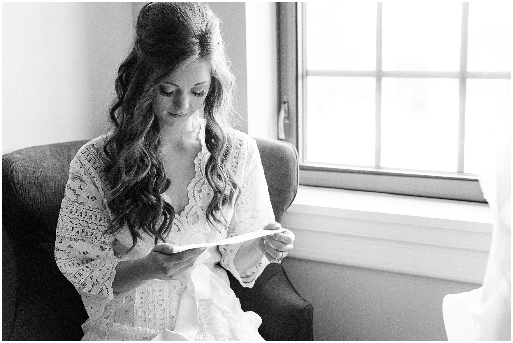 The bride reads a letter from the groom before their University of Notre Dame wedding.