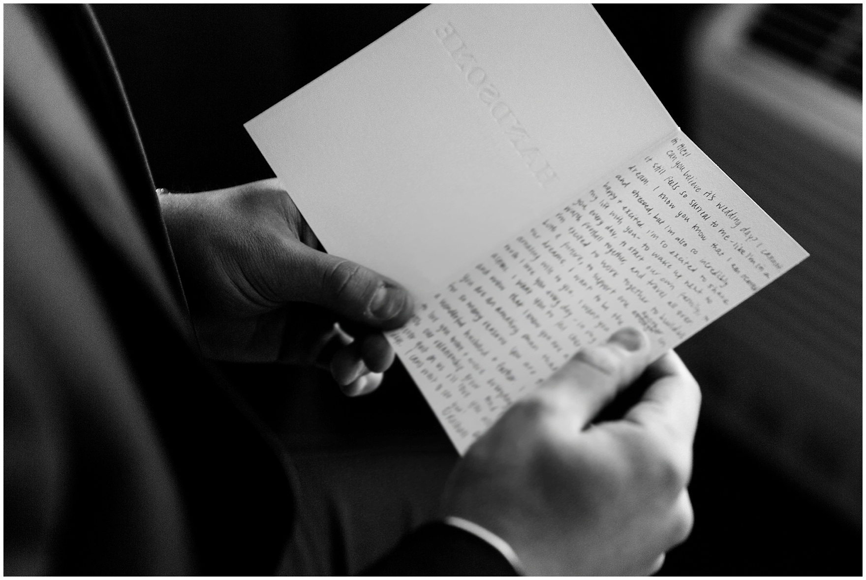 The groom reads a letter from his bride before a University of Notre Dame wedding.