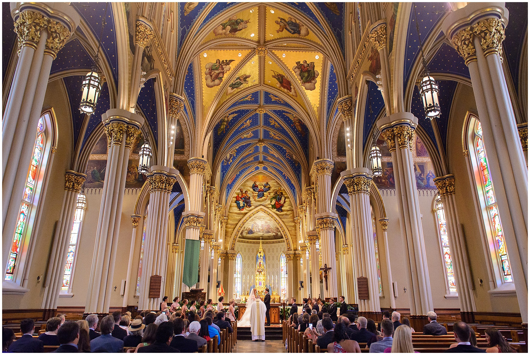 The bride and groom exchange vows at the Basilica of the Sacred Heart during a University of Notre Dame wedding.