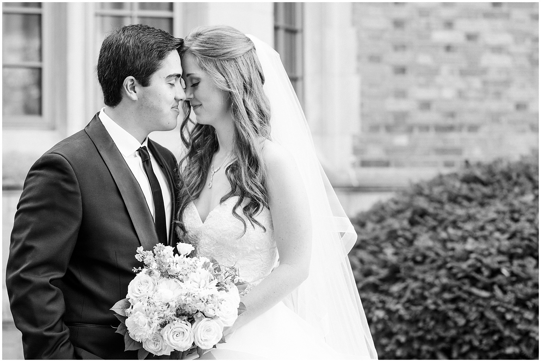 The bride and groom share a quiet moment after their University of Notre Dame wedding.