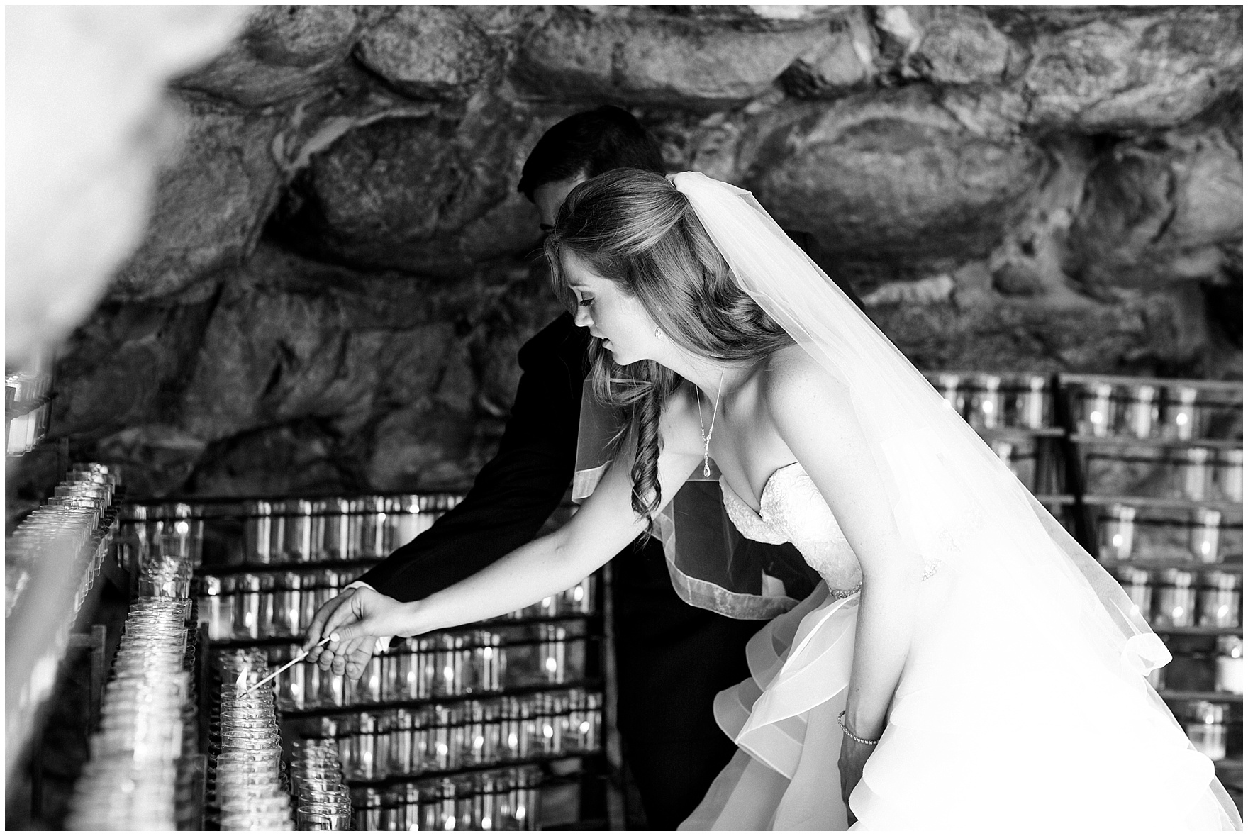 The bride and groom light a candle in the grotto during a University of Notre Dame wedding.