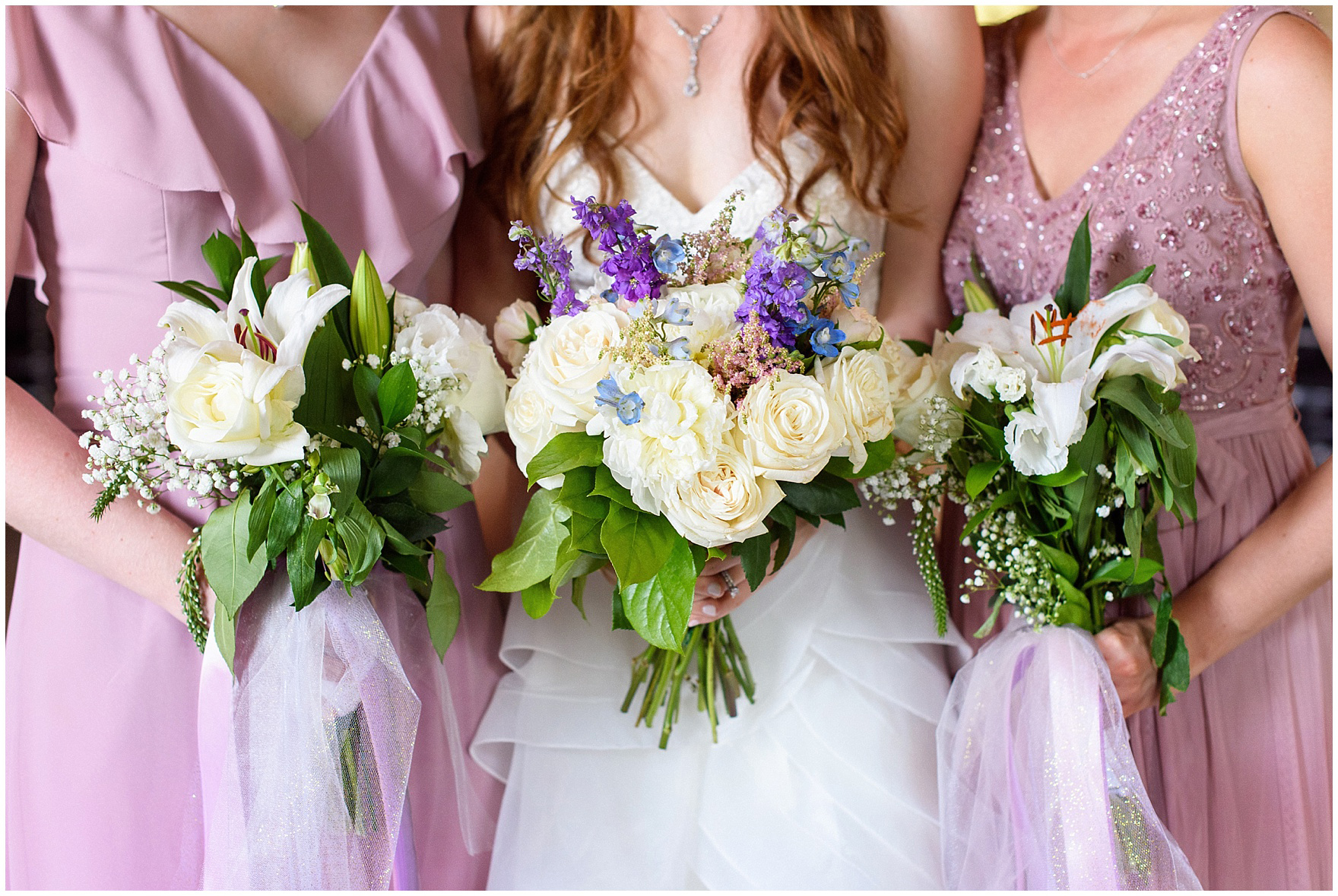 Purple and blue bride's and bridesmaids bouquets for a University of Notre Dame wedding.