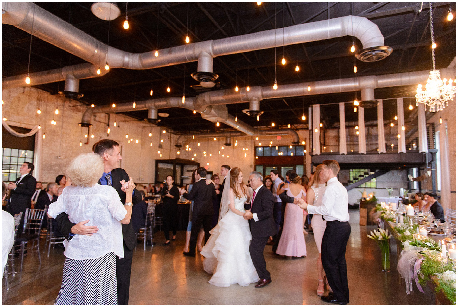 Guests dance during a wedding reception at The Brick in South Bend, following a University of Notre Dame wedding.