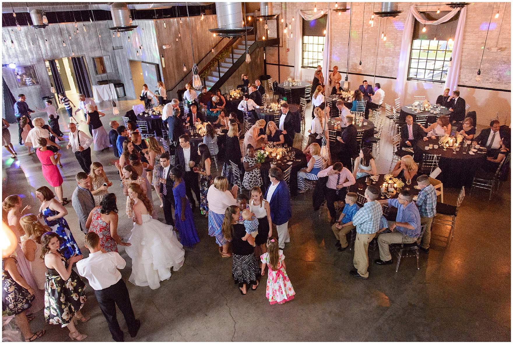 Guests mingle during a wedding reception at The Brick in South Bend, following a University of Notre Dame wedding.