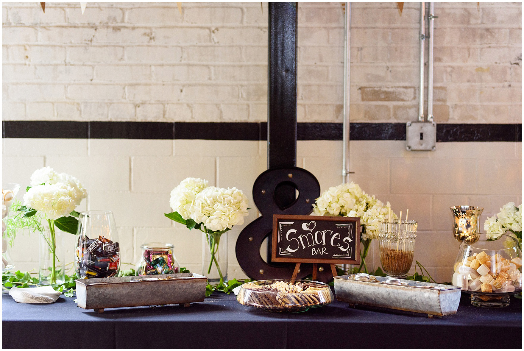 A smores table is set up for a wedding reception at The Brick in South Bend, following a University of Notre Dame wedding.